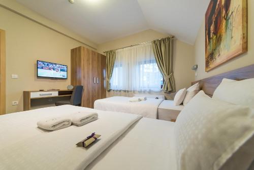 Кровать или кровати в номере Hotel Mons