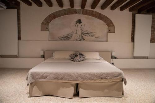 Un ou plusieurs lits dans un hébergement de l'établissement Casa Marco Polo