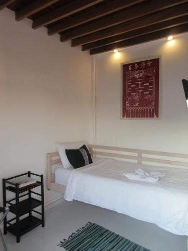 A bed or beds in a room at Moonlight Champa