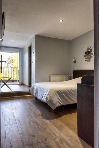Un ou plusieurs lits dans un hébergement de l'établissement Hôtel François 1er