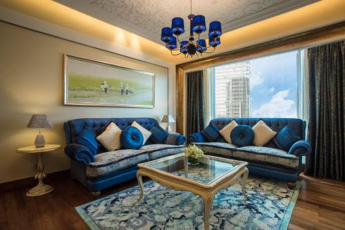 A seating area at The Reverie Saigon Residential Suites