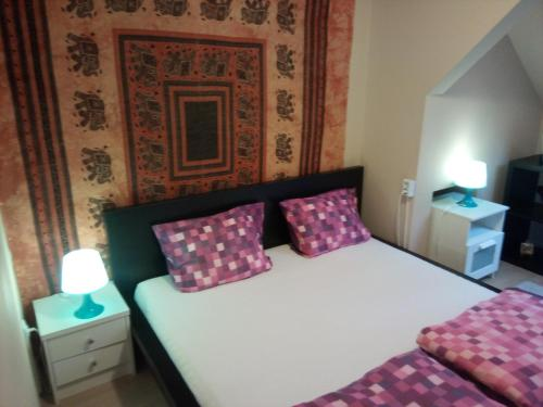 A bed or beds in a room at Suburb Apartman