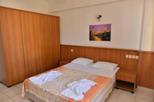 Кровать или кровати в номере Orange Garden Apart Hotel