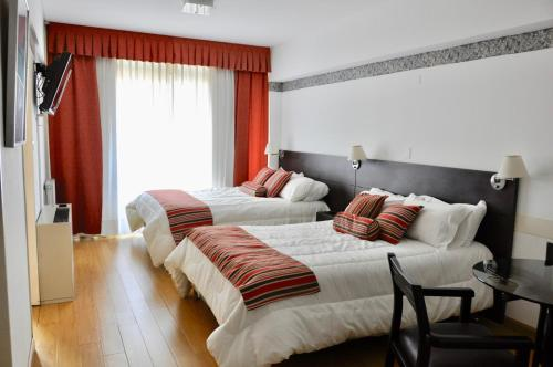A bed or beds in a room at Golf Tower Suites & Apartments