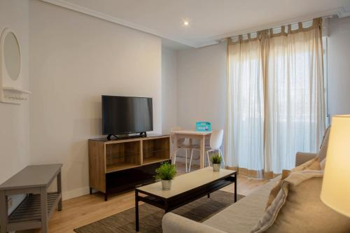 A television and/or entertainment center at Penthouse with terrace in Guindalera