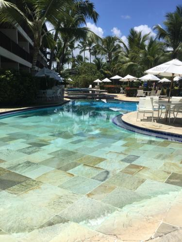 The swimming pool at or near Flat Nannai Residence - Vila Beijupirá
