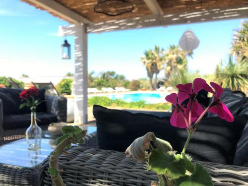 A porch or other outdoor area at Le Lanterne Resort