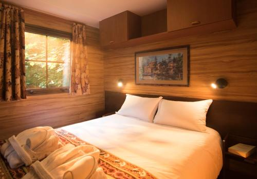 A bed or beds in a room at Disney's Davy Crockett Ranch