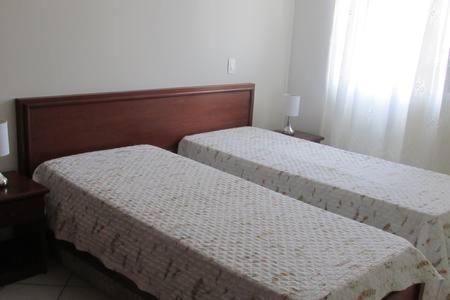 Cama o camas de una habitación en Gregoleti Canasvieiras. 1 quarto
