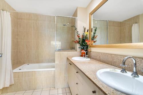 A bathroom at The Lakes Resort Cairns North 1221