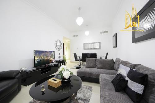 A seating area at Golf View 2 BR -Ahlan Holiday Homes