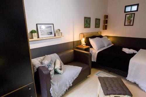 A bed or beds in a room at Meu lugar na Cidade Baixa