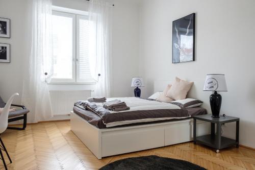 Säng eller sängar i ett rum på Vienna Experience