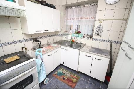 Una cocina o zona de cocina en Cama king y cama 2 plazas Lastarria
