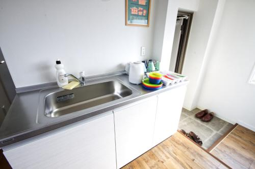 A kitchen or kitchenette at Murakami building 4F