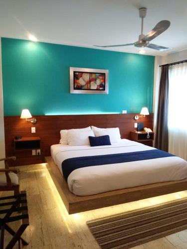A bed or beds in a room at Araucaria Hotel Boutique
