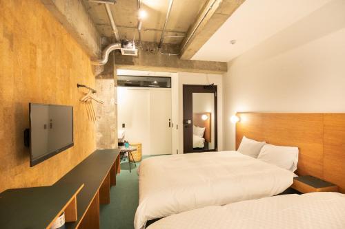 Voodi või voodid majutusasutuse EARTHAMNS AMEMURA toas