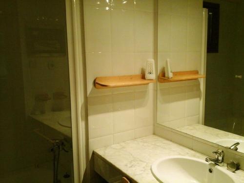 A bathroom at Apartamentos Tanau