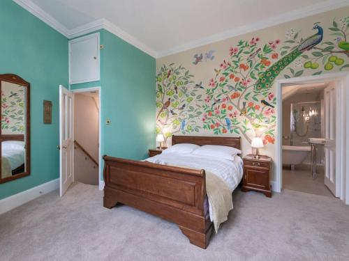 A bed or beds in a room at The Counting House