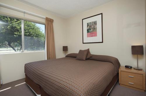 A bed or beds in a room at Forrest Hotel & Apartments
