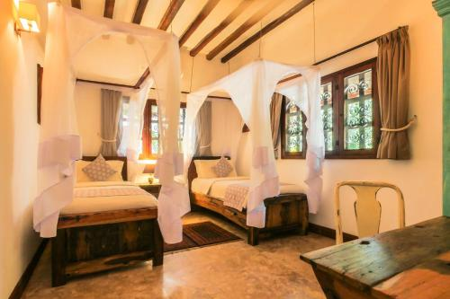 A bed or beds in a room at Kidoti Villas by Z