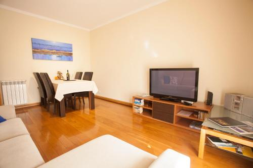 A television and/or entertainment center at Porto Gaia City and Beach by MP
