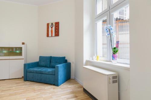 A seating area at Apartament Garncarska