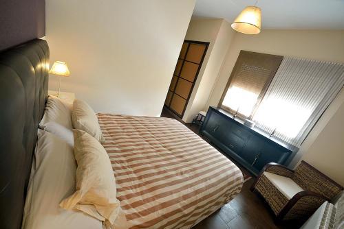 """Cama o camas de una habitación en Casa Rural """"El Parador"""""""