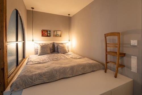 Rúm í herbergi á Apartment Vienna. Your second home abroad