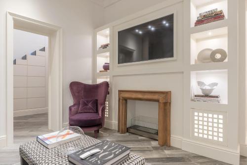 TV o dispositivi per l'intrattenimento presso Ripetta Boutique Apartment