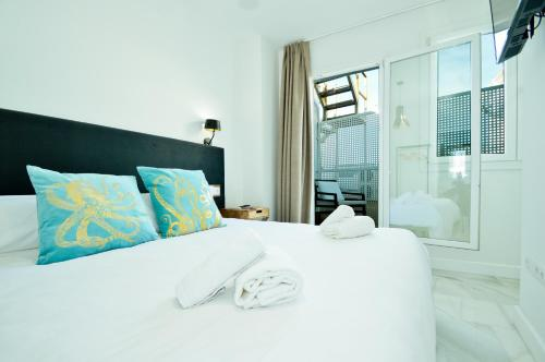 A bed or beds in a room at NineSuites