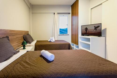 A bed or beds in a room at Dream Away Uruaú Beach Residences