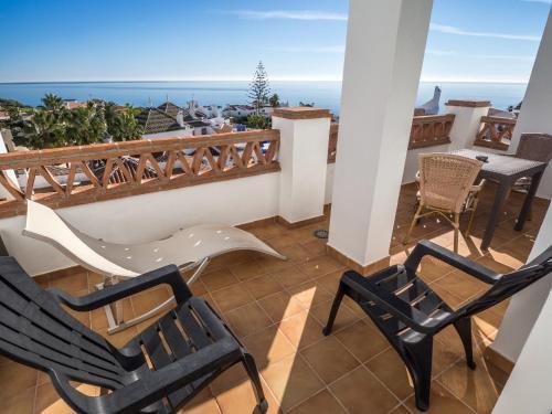 Un balcón o terraza de Apartamentos Chimenea