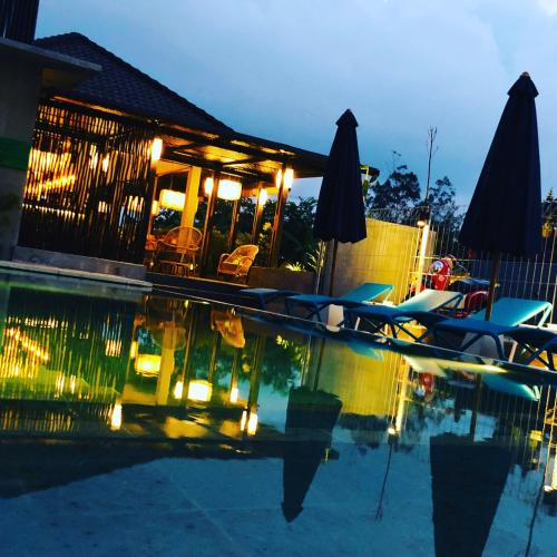 The swimming pool at or near Wasabi