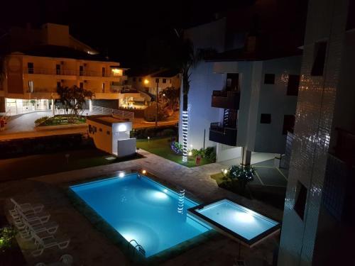 A view of the pool at Apto 2suítes 30m da praia or nearby