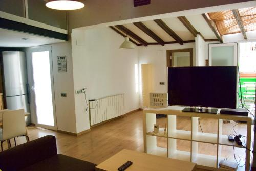 A television and/or entertainment center at RUZAFA. Nice apartment and Terrace.