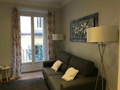 אזור ישיבה ב-Stay At Home Madrid Apartments IV