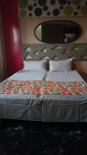 A bed or beds in a room at Raj Regency
