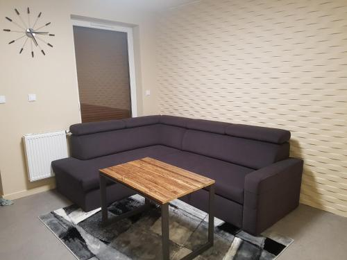A seating area at Nowoczesny Apartament w Centrum