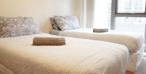 A bed or beds in a room at Nice Castleforbes Square Excellent Location in Dublin