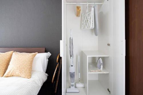 Een bed of bedden in een kamer bij FF260 10mins to sta 5mins to Ikebukuro 4ppl wifi