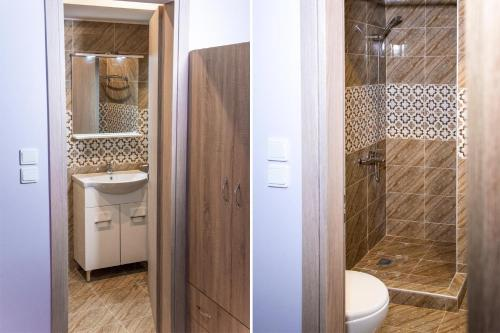 Ein Badezimmer in der Unterkunft Acropolis Suites 54 Purple