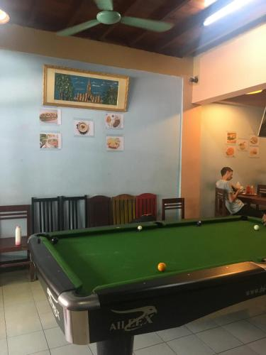A pool table at Dream Home Hostel
