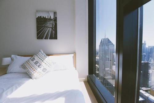 A bed or beds in a room at HFN Southern Cross Apartment