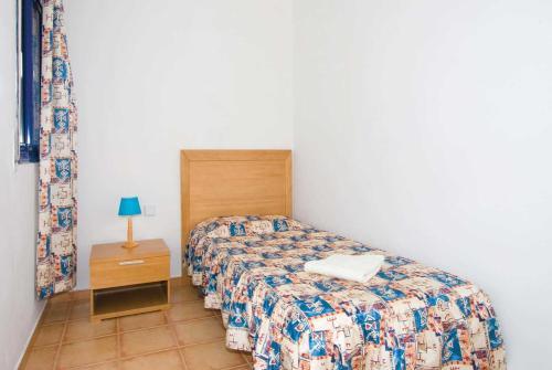 Een bed of bedden in een kamer bij Corralejo Villa Sleeps 5 WiFi