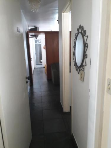 A bathroom at Sala, quarto, cozinha e varanda localização excelente