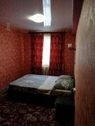 Кровать или кровати в номере Uyt Inn заселение только по звонку!