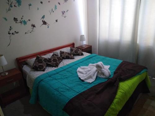 Cama o camas de una habitación en Santiago Apartamentos Centro