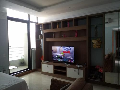 A television and/or entertainment center at Flat Tropical Particular