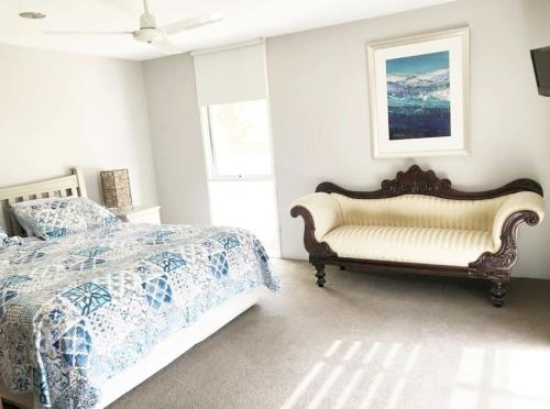 A bed or beds in a room at Ocean Grove Beach House